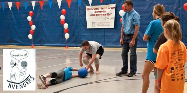 Children learn how to play goalball.
