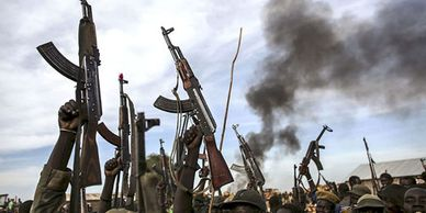 Guns raised in air in South Sudan civil war