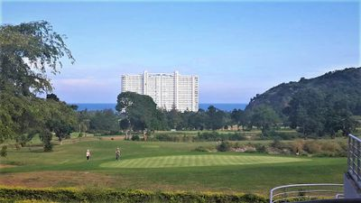 Hua Hin Korea golf course with Milford Paradise hotel in the back, Golf Sea City Guest House Hua Hin