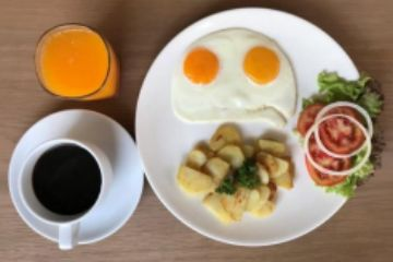 Golf Sea City guest house Hua Hin Special Breakfast is your choice of 2 eggs with tea or coffee.