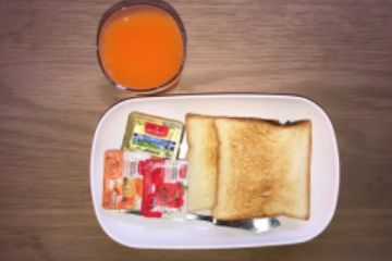 Golf Sea City guest house Hua Hin Fast Breakfast is 2 Toasts with jam and butter with orange juice