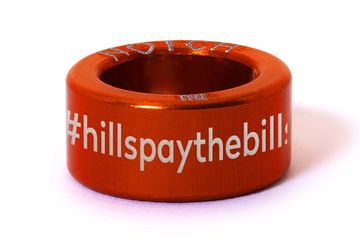 Raced Coaching Notch with hashtag #hillspaythebills in orange.
