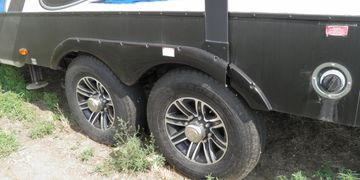 True Goo Tire Sealant, Trailers are 8-12 oz/tire.  Larger HD trailers and semi trucks are 16 oz/tire
