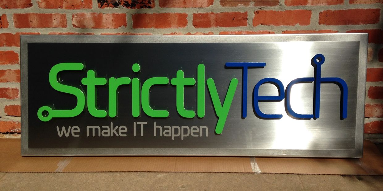 Brushed stainless steel sign with raised powder coated logo and etched tag line.