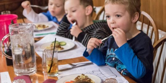 Kids eating dinner at Valhalla Lodge Perisher