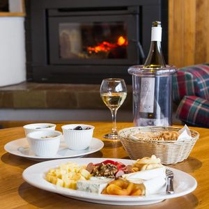 Après by the fire at Valhalla Perisher. Ski lodge living. More than just Perisher accommodation