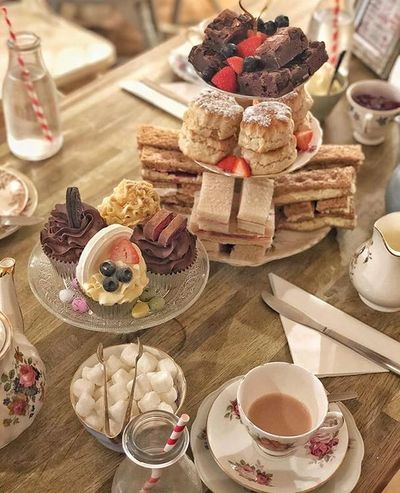 Vintage afternoon tea, finger sandwiches, scones, fresh clotted cream and strawberry jam, cupcakes and brownies