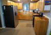 Main House - rustic kitchen with stainless appliances