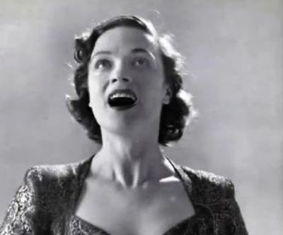 Woman joyfully singing.
