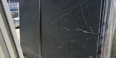 Soapstone slabs at Royal Stone.  Royal Stone in a tile shop in Los Angeles with large showroom.