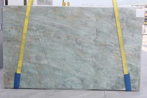 Quartzite slabs at Royal Stone.  Royal Stone in a tile shop in Los Angeles with large showroom.
