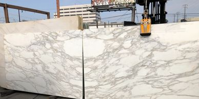 Marble  slabs at Royal Stone.  Royal Stone in a tile shop in Los Angeles with large showroom.