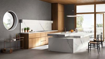 Porcelain Slab Kitchen and island with Carrara or Statuary Vein look.