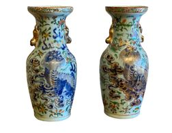 Pair of Chinese Vases With Foo Lions