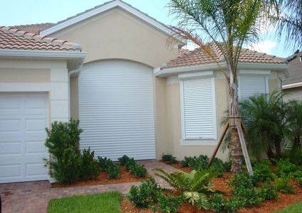 Fully protected home with rolling hurricane shutters