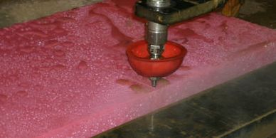 "Industrial cutting of 3"" thick UHMW plastic by the OMAX waterjet in Stevensville, MT."