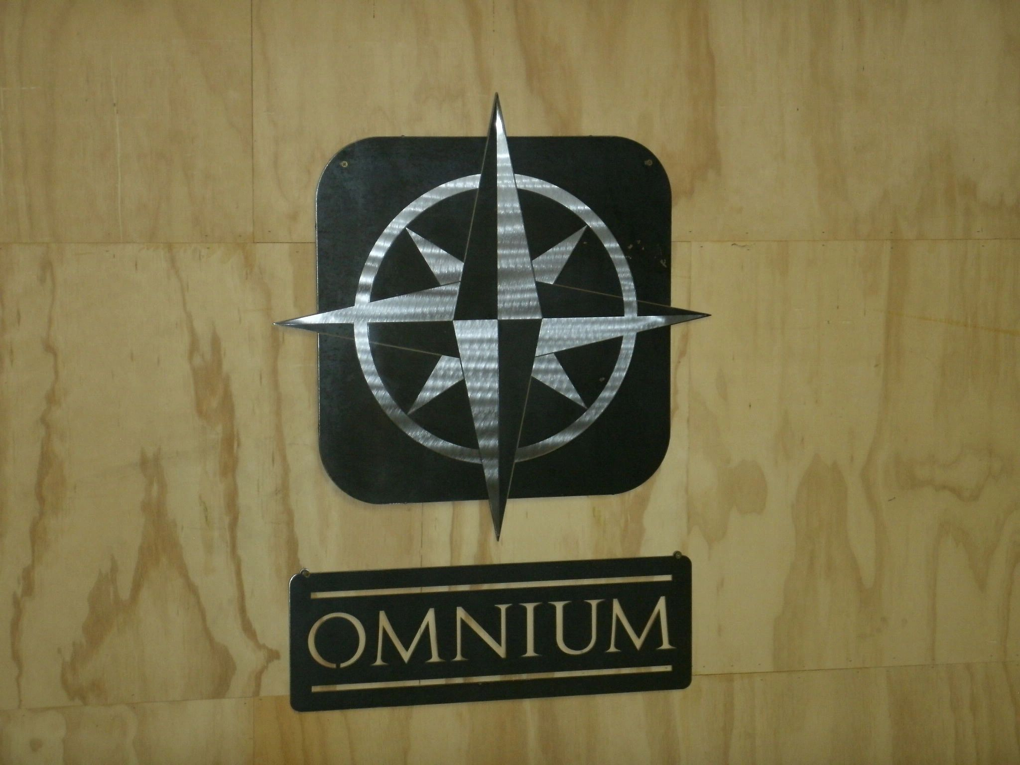 Custom business sign made from stainless steel and plain steel.