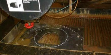 "OMAX Waterjet cutting a 1/2"" thick custom bell housing for Vintage Jag Works."