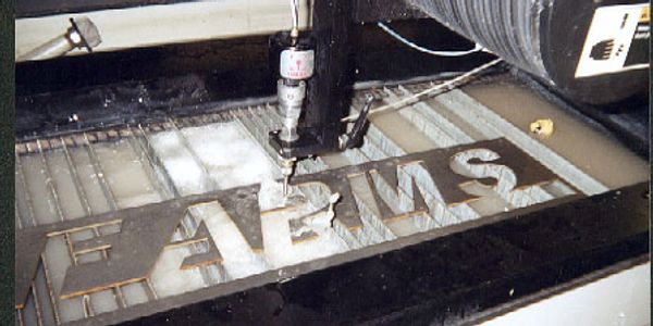 Waterjet cutting custom signs on the OMAX waterjet.
