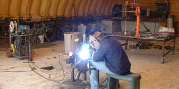 Welding and Metal Fabrication.  Flux cored arc welding in progress by me.