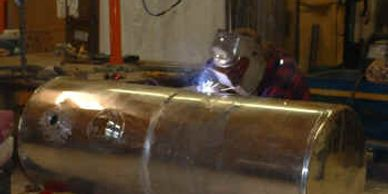 Aluminum welding being performed on a tank.