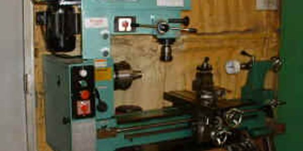 Machine shop work being done on the lathe and mill in the Rapid Creek Cutters shop.