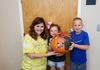 Mrs. Trimm with Team  little Madi and Brice and their pumpkin