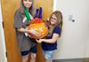 Madi and Caylen with their pumpkin