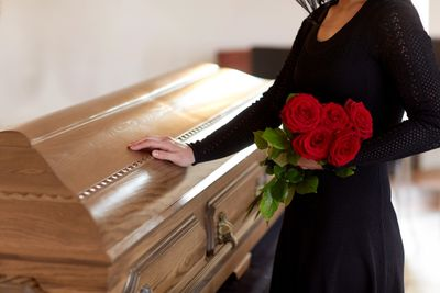 Funeral officiant, funeral, casket, mourn, grief