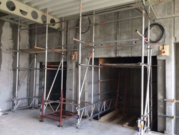 Picture of lift shaft scaffold cantilever suspended truss out