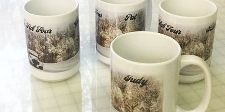 sublimation printed mugs with fine art on them.