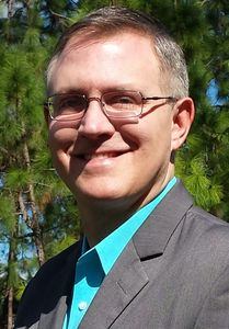 James Sutton, Business Manager and Officiant