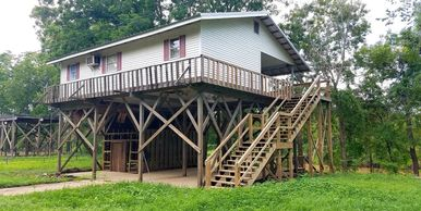 COZY 2 BEDROOM, 1 BATH CAMP ON THE HOMOCHITTO RIVER AT LAKE MARY IN WOODVILLE, MS. CAMP IS ELEVATED
