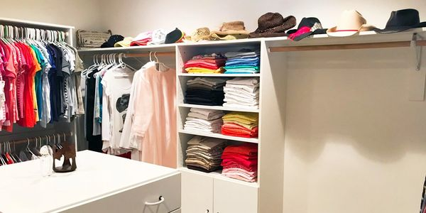 decluttered and organized closet and drawers.  Color coded and folded clothing in closet.  Peace of mind