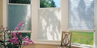 Sheer shades.  Translucent fabric shades for windows.