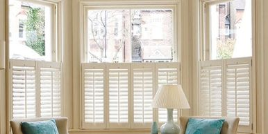 Cafe style interior shutters.  Half window shutters for bay windows.  Shutters only half the window.