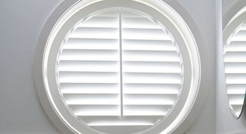A circle shutter for a circle window.  Custom shaped shutters for special size windows or openings.