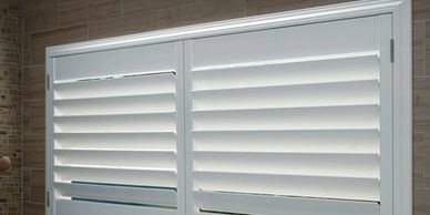 Faux wood shutters made of poly synthetics  and/or PVC vinyl. White faux wood window shutters.