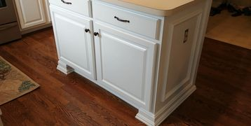 Take your standard base cabinet and enhance it with wood trim molding.