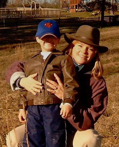 Lisa Reagan and her son on their farm in Virginia in 2003.