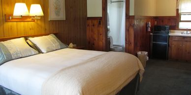 Room 5, 1 queen bed,  ½ bath with walk in shower.