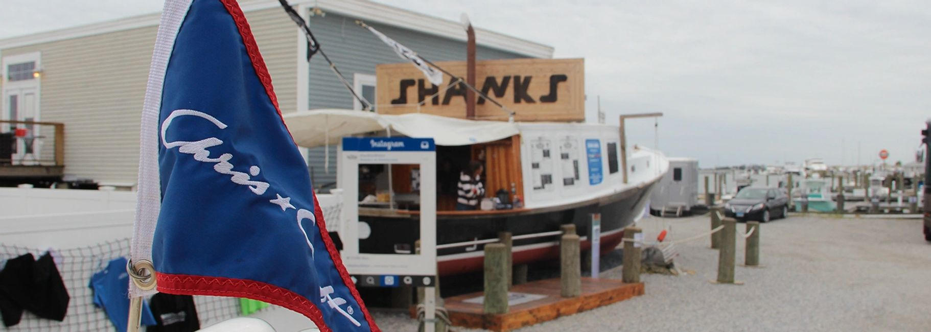 Chris Craft featured in front of Shanks Waterfront Dining in Clinton, CT