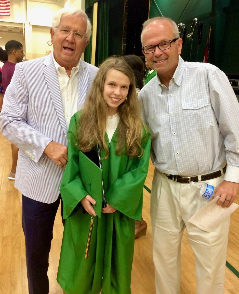 Robert Russell (right) and his father Archie (left) at his daughter's middle school graduation. Robert's father stayed at a hotel with him during his daily chemotherapy and radiation treatments, and returned to stay at Caring House with him during a month of hyperbaric oxygen treatments.
