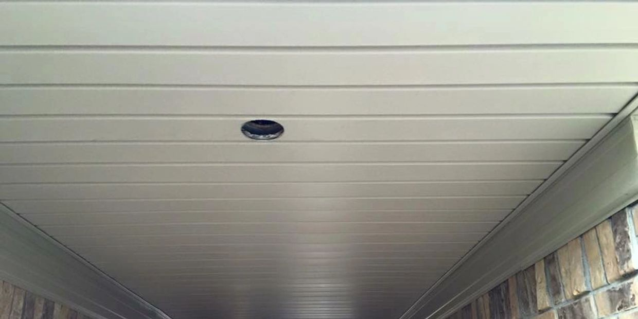 Vinyl soffit under breezeway, with metal trim