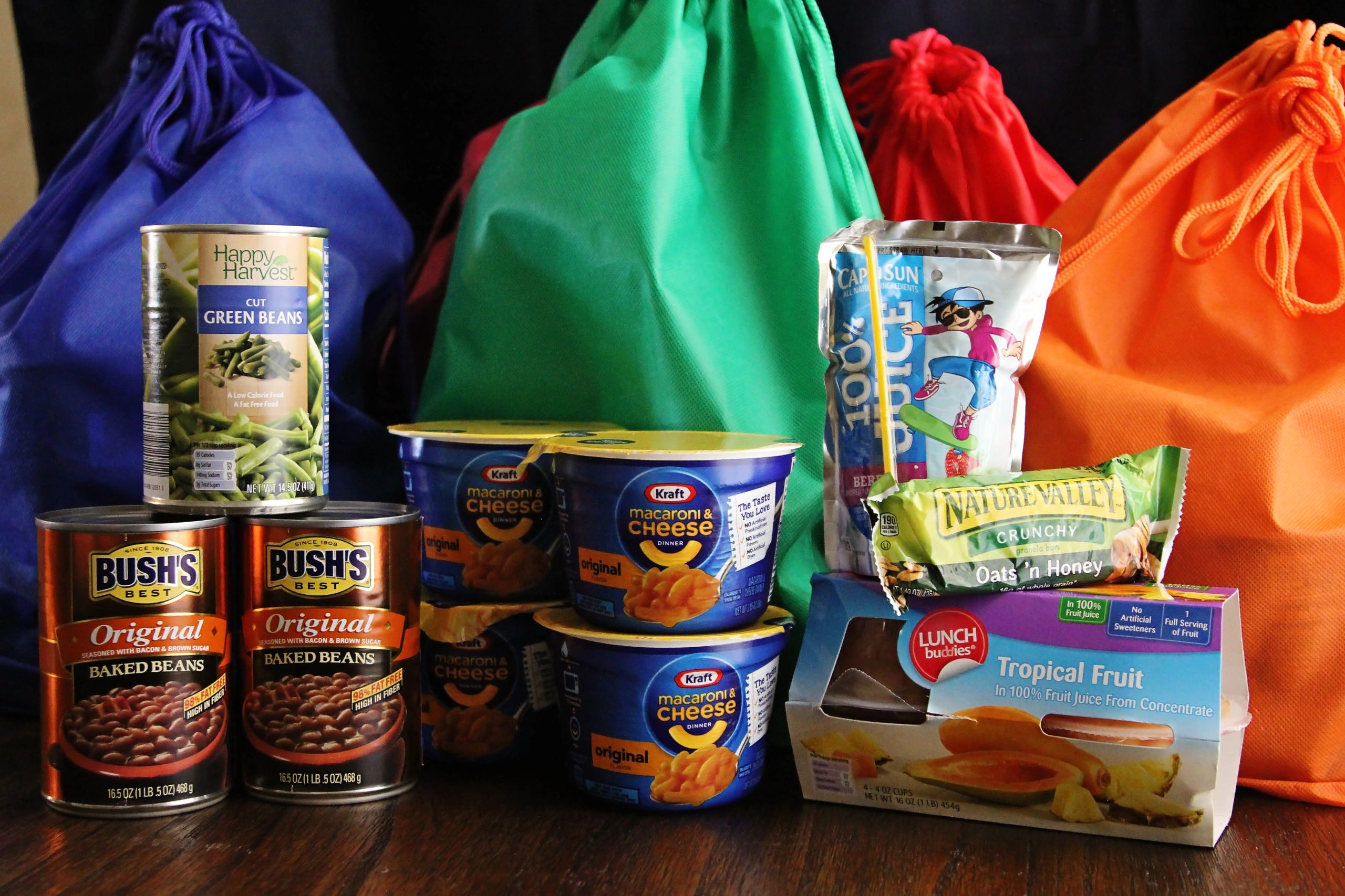 Image shows contents of healthy backpack meals to be distributed by teachers to hungry kids