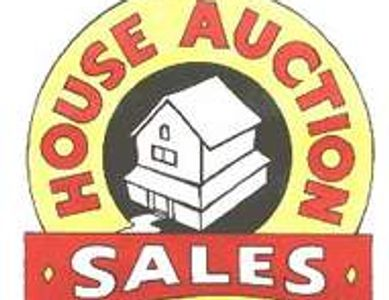 A forsale board showing a house with the words house auction sales around it.
