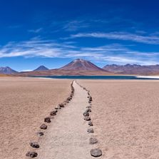 Winding path through to Laguna (Lake) Miscanti and volcanoes, Andes Mountains, Atacama Desert, Chile