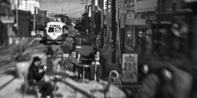 Men sitting at a cafe with a vintage streetcar in the background, the Castro, San Francisco