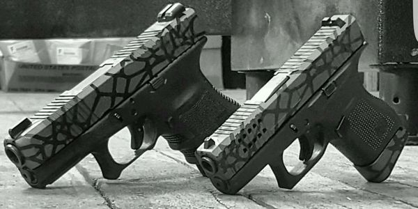 Custom glock pistols and cerakote work with stippling and porting