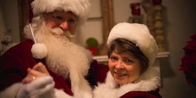 Santa Claus and Mrs. C enjoying a dance.  The Sleigh Rider Premier Real Bearded Santa Claus www.thesleighrider.com